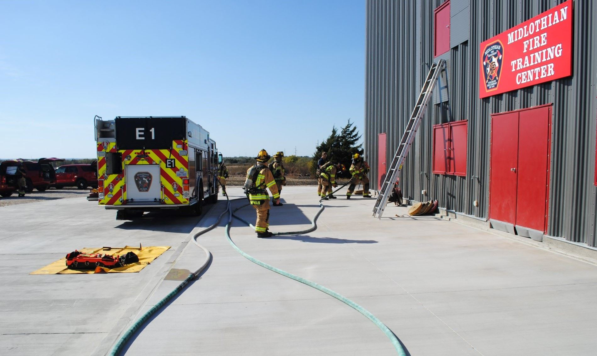 Midlothian Fire Training Center - Engine 1 and Firefighters training with hose/ladder